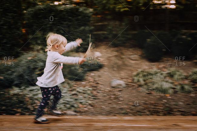 Little girl running outside