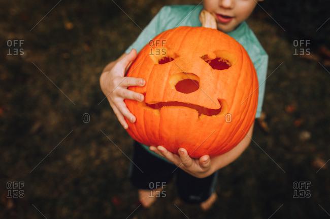 Boy holding jack-o-lantern