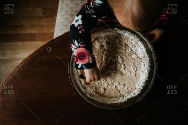 Little girl stirring baking mix