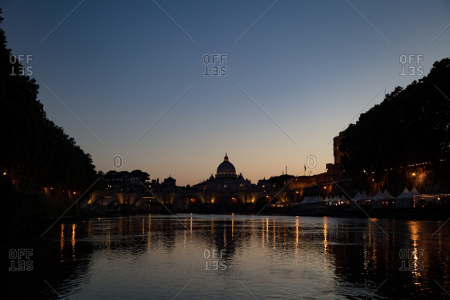 Ponte Vecchio and St. Peter's Basilica at night in Rome, Italy