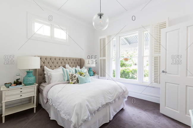 Master bedroom styled in neutral classic tones