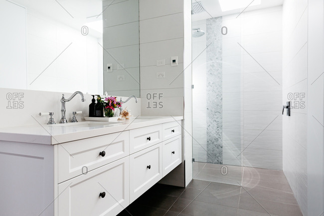 Spacious luxury bathroom with walk in shower in monochrome country style