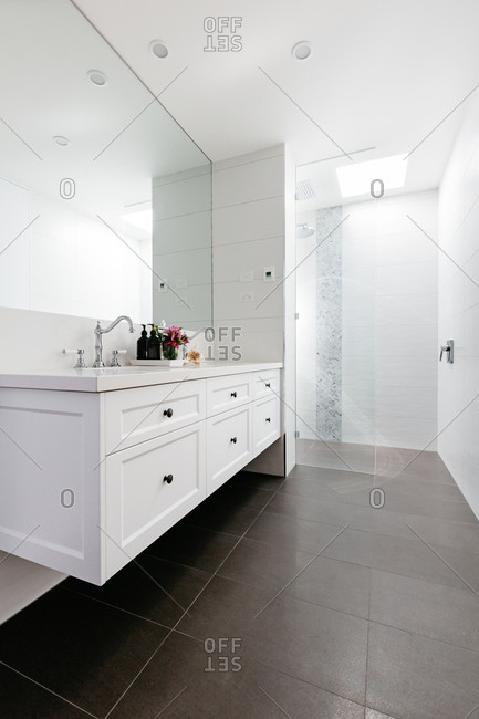 Luxury bathroom with walk in shower in monochrome country style