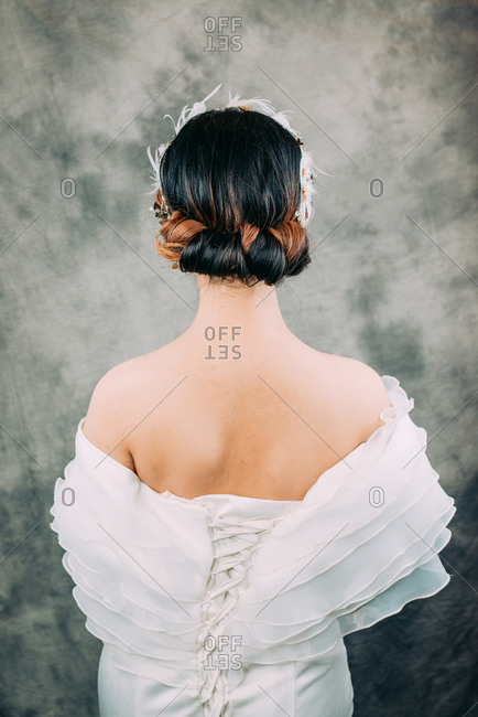 Portrait of a young Chinese woman in a modern bridal dress and hair style