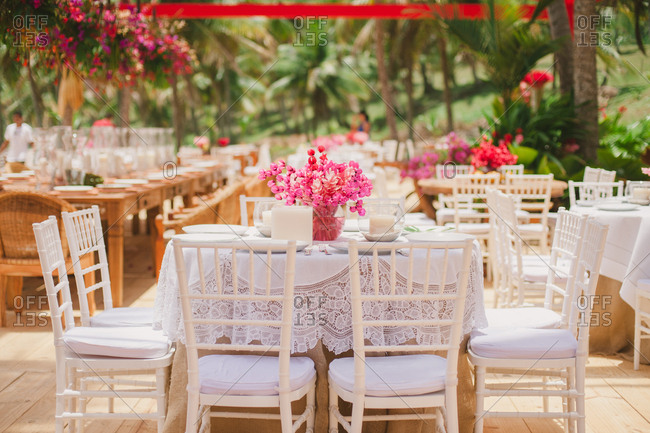 Set tables at reception for outdoor beach wedding
