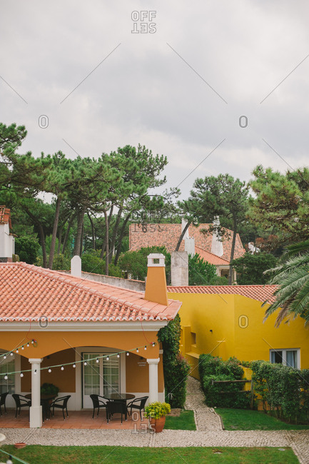 Cascais, Portugal - September 27, 2014: Outdoor patio and buildings with tile rooftops