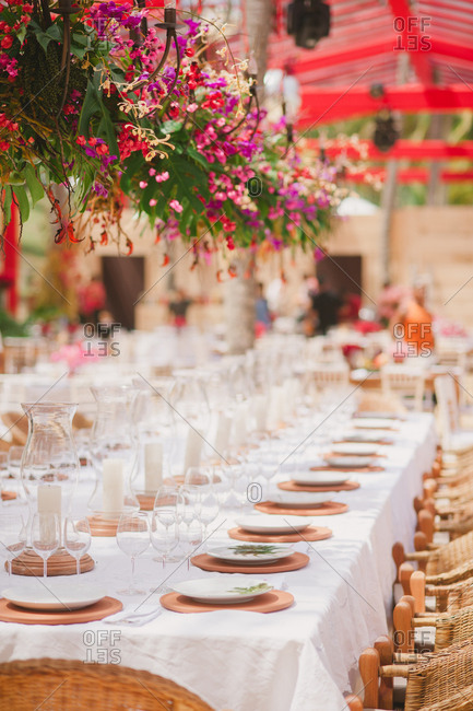 Set tables at reception for outdoor wedding