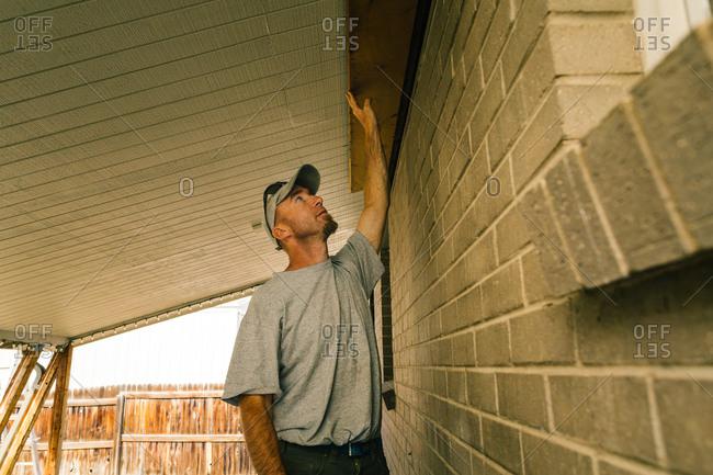 Man inspecting underside of roof