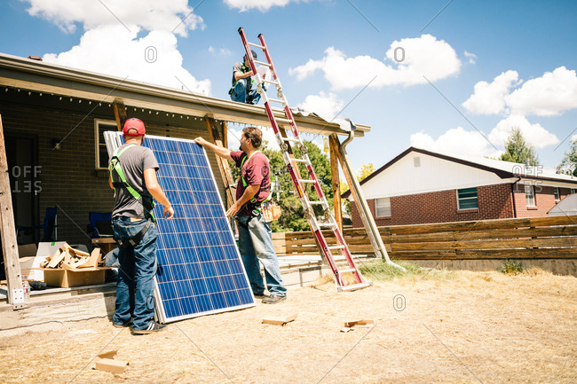Construction workers preparing to install solar panels