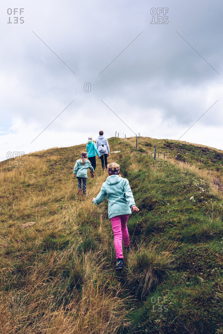 Mother and children hiking in Tyrol, Austria