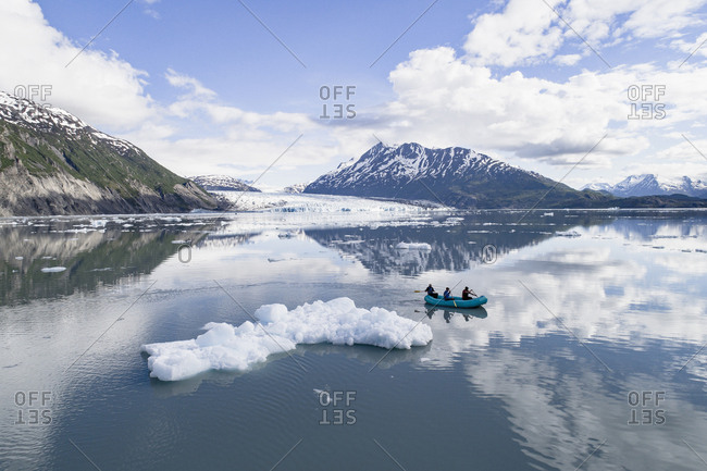 People rafting in glacier lagoon against sky, Lake George, Palmer, Alaska, USA