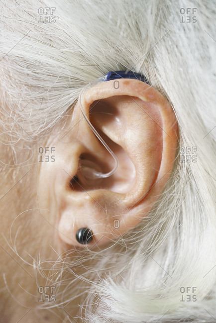 Close-up of senior woman's ear wearing hearing aid