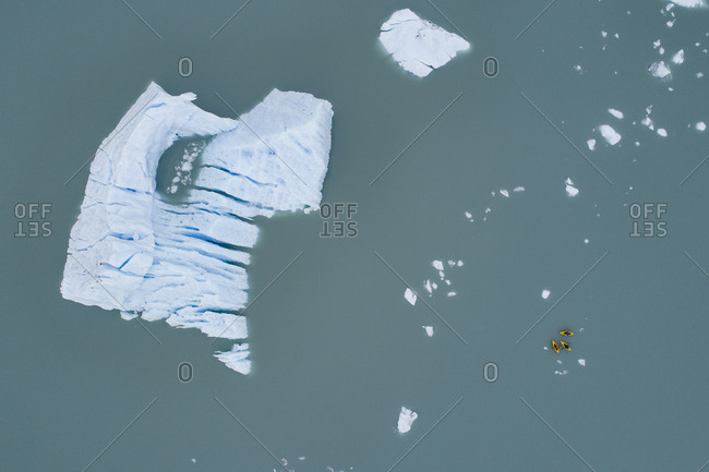 Aerial view of canoes and iceberg in lagoon, Lake Palmer, Anchorage, Alaska, USA