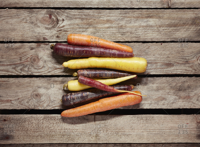 Directly above shot of various carrots on wooden table