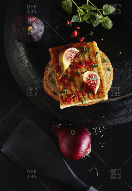 Directly above shot of open faced sandwich with ingredients on granite