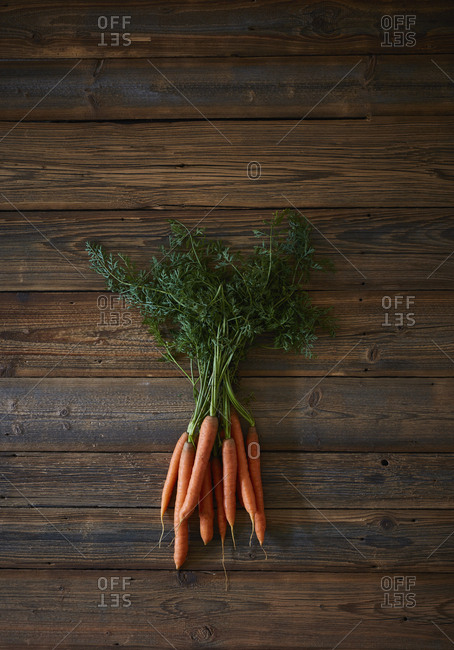 High angle view of fresh carrots on wooden table