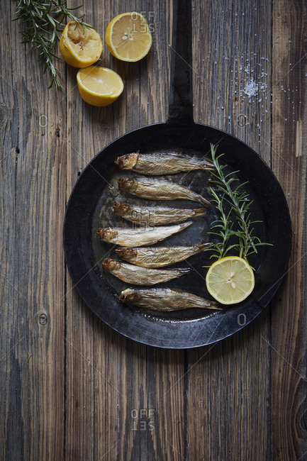 Directly above shot of seafood in cooking pan on wooden table