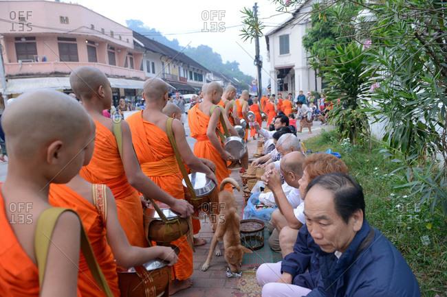 Luang Prabang, Laos - November 3, 2017: Monks going on alms round