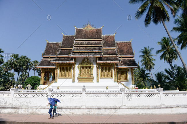 Luang Prabang, Laos - November 3, 2017: City street in front of the Luang Prabang National Museum