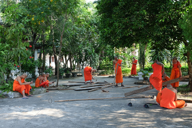 Laos - November 5, 2017: Monks working inside the temple