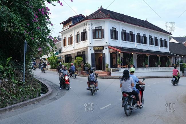 Luang Prabang, Laos - November 3, 2017: Street of Luang Prabang in front of Saynamkhan River View Hotel