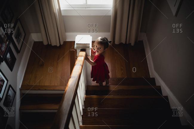 Toddler walking down stairway