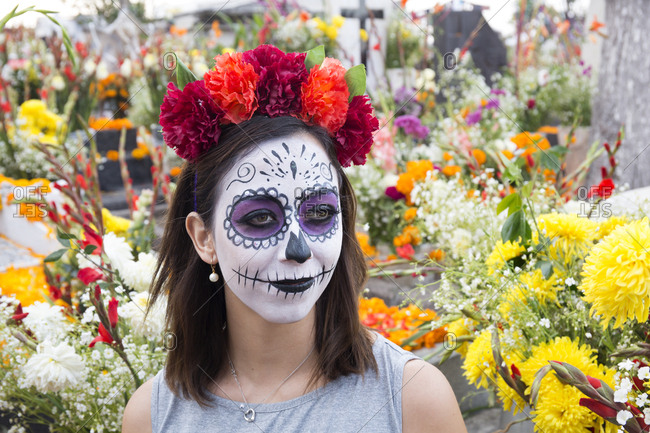Mexico City, Mexico - November 2, 2017: Woman with face painted at the Day of the dead celebrations at Zocalo square
