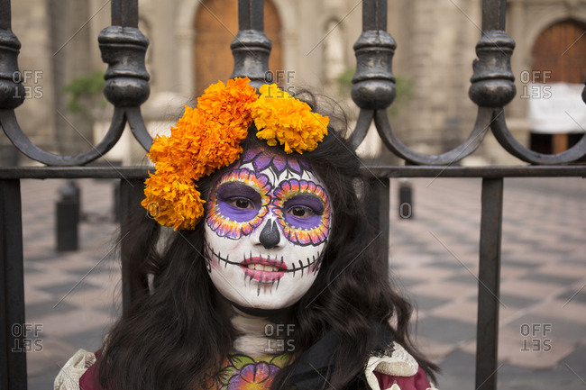 Mexico City, Mexico - November 1, 2017: Woman with painted face at the Day of the dead celebrations at Zocalo square