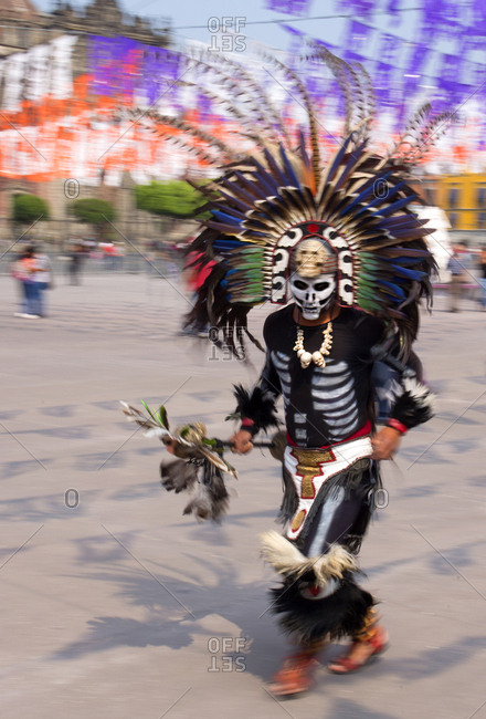 Mexico City, Mexico - November 1, 2017: Man dancing in costume at the Day of the dead celebrations at Zocalo square