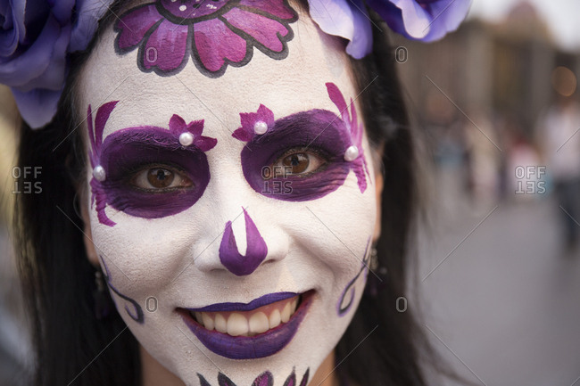 Mexico City, Mexico - November 1, 2017: Woman with painted face at the Day of the dead celebrations