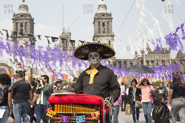 Mexico City, Mexico - November 1, 2017: Organ grinder playing at the Day of the dead celebrations at Zocalo square