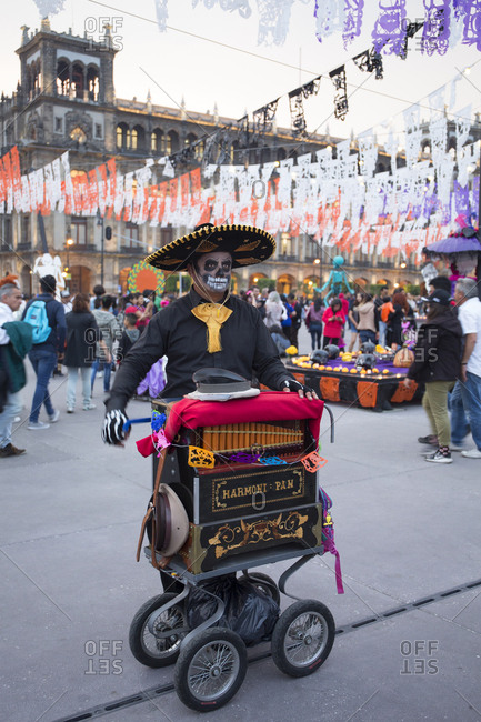 Mexico City, Mexico - November 1, 2017: Organ grinder at the Day of the dead celebrations at Zocalo square