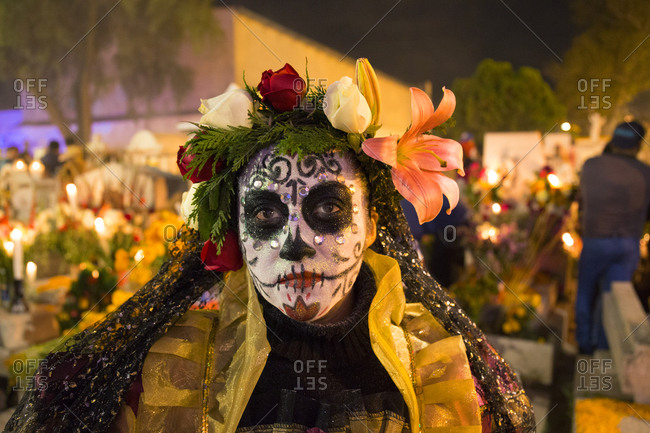Mexico City, Mexico - November 2, 2017: Woman dressed in costume at the Day of the dead celebrations at Mixquic town cemetery