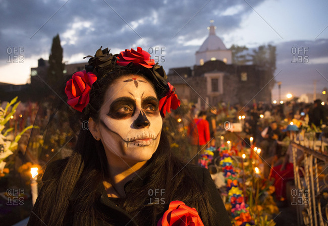 Mexico City, Mexico - November 2, 2017: Woman with painted face at the Day of the dead celebrations at Mixquic town cemetery