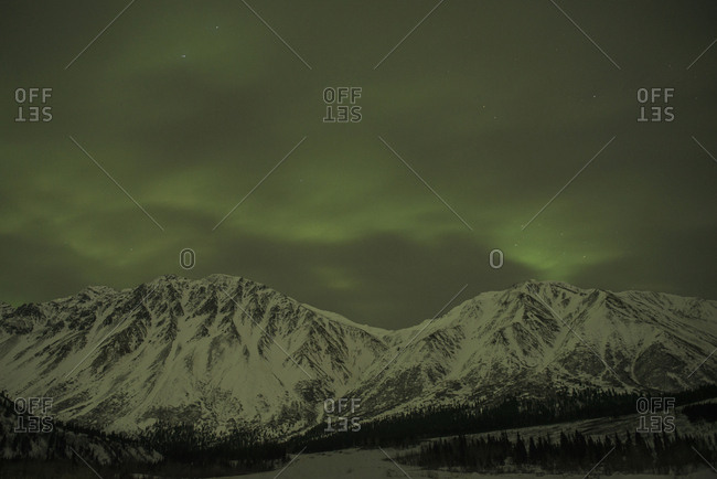 Majestic view of snowcapped mountains against aurora borealis during night