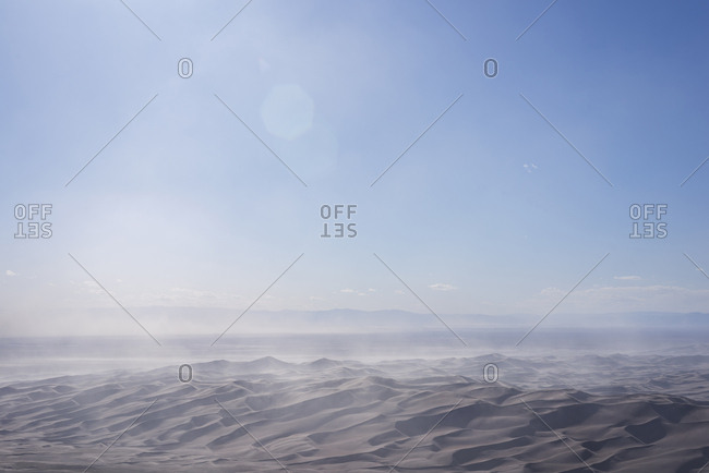 Scenic view of desert against sky at Great Sand Dunes National Park and Reserve during sunny day