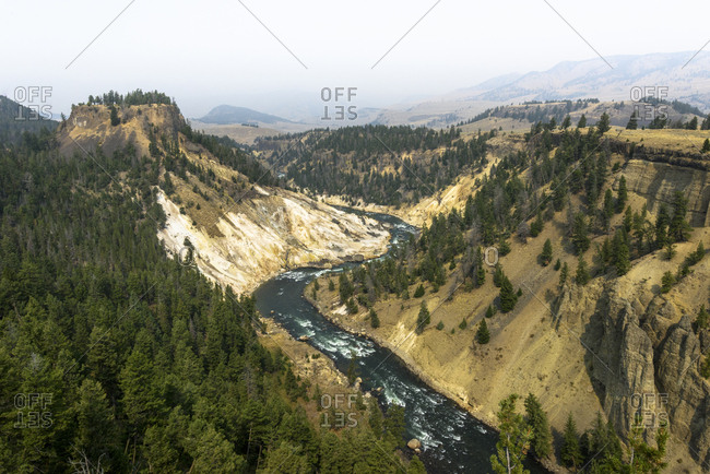 High angle idyllic view of River flowing amidst mountains