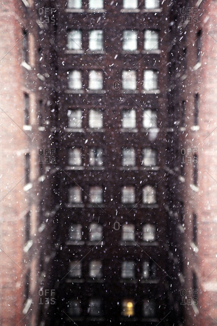 View of building during snowfall in city