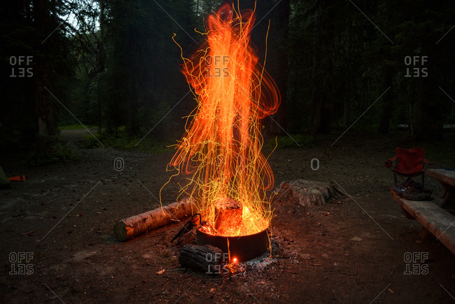 Close-up of campfire burning at campsite