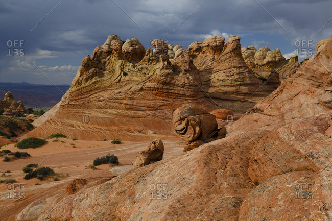 Majestic view of rock formations against stormy clouds