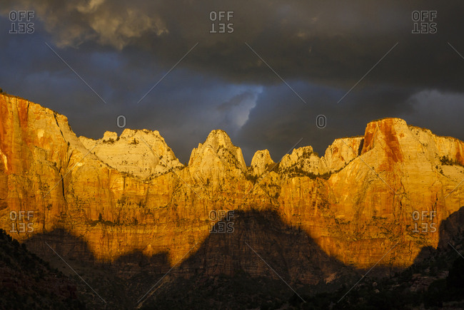 Low angle idyllic view of mountain ranges against stormy clouds at Zion National Park