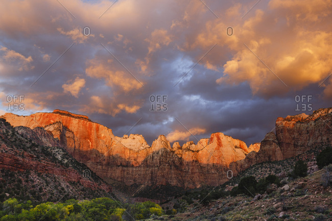 Low angle idyllic view of mountain ranges against cloudy sky at Zion National Park