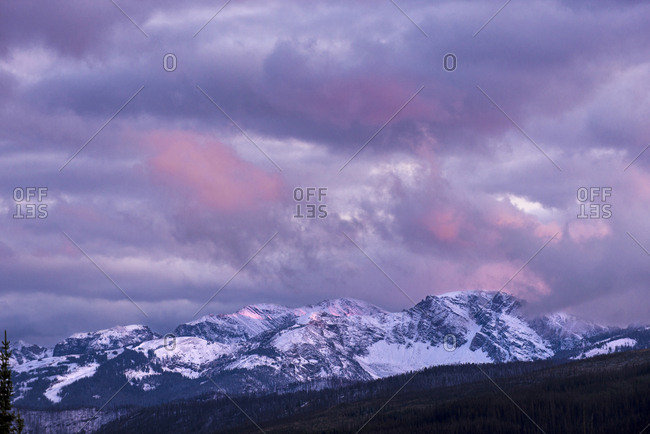 Scenic view of snowcapped mountains against cloudy sky at Grand Teton National Park