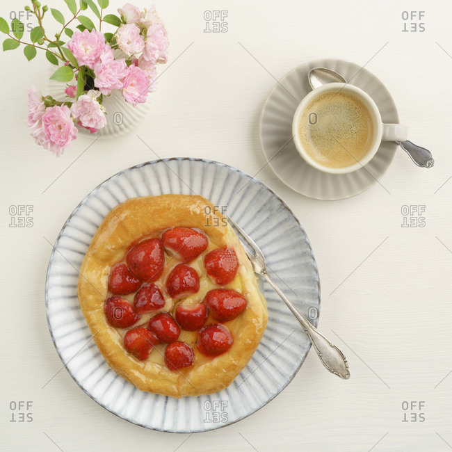 Flowers- coffee and Danish pastry with strawberries and custard