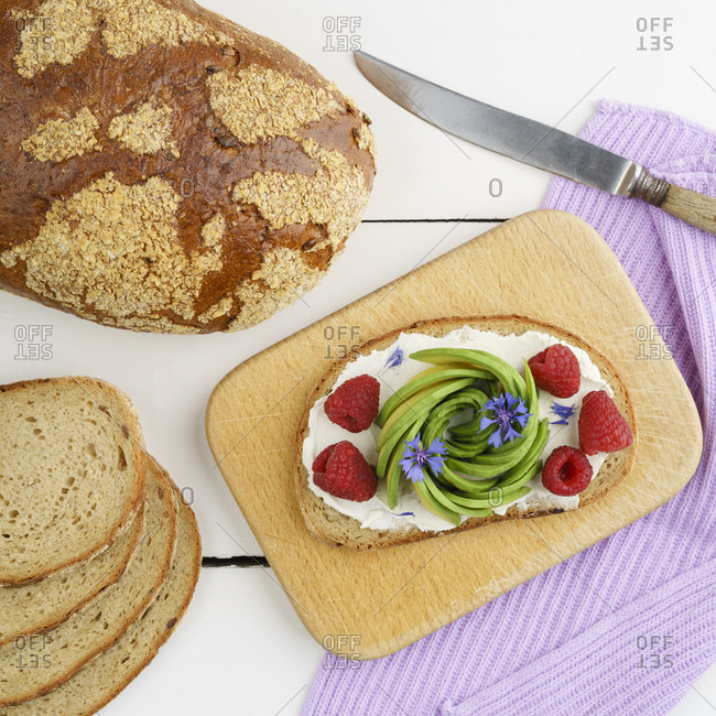 Bread with edible flowers- raspberries and avocado