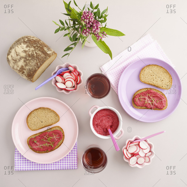 Vegan supper with bread- beetroot spread- red radish and juice