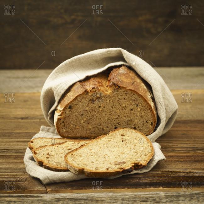 Sliced bread in linen cloth