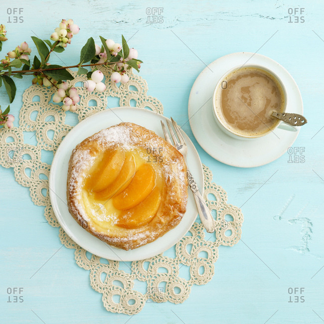 Flowers- coffee and Danish pastry with peaches and custard