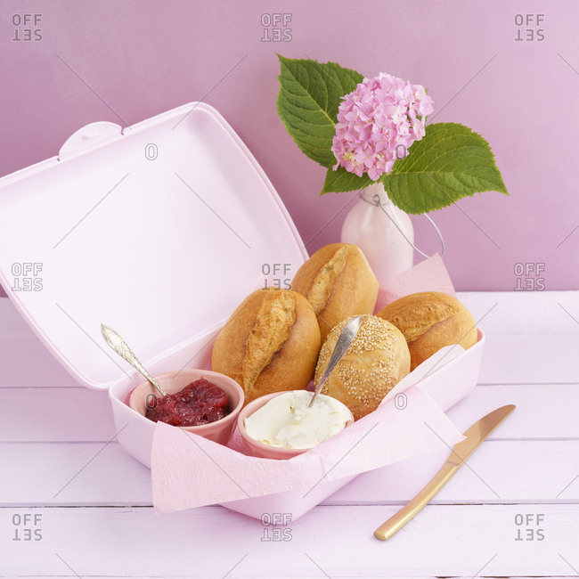 Lunch box with bread rolls- jam and cream cheese