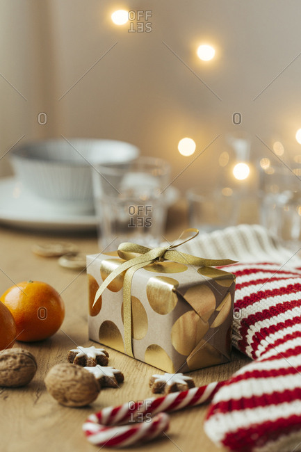Christmas present- tangerines- walnuts- candy canes and cinnamon stars